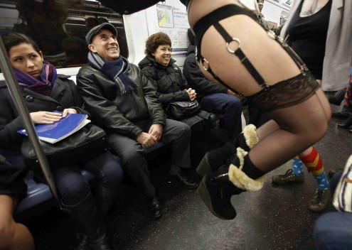 People watch as participants in the No Pants Subway Ride take the 6 train downtown in New York